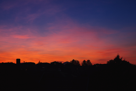 Colorful sunset above small Balkan town, early autumn moments.