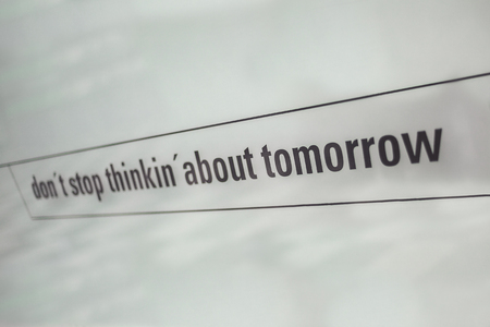Textual commercial message printed on white glass.