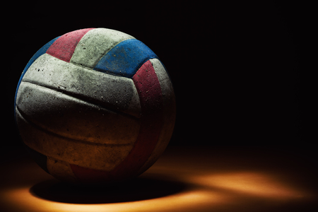 Closeup of an dirty volleyball colorful ball.
