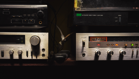 Radio tuner, CD player, gramophone and cassette deck.