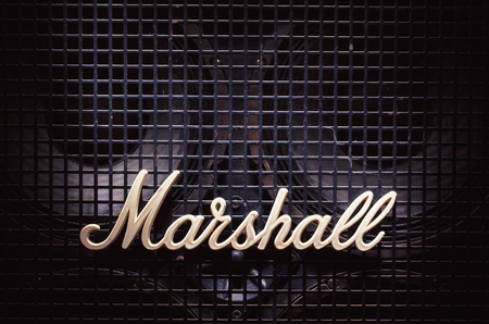 Cacak, Serbia - December 13, 2017: Marshall logo on old bass speaker with metal net in front of woofers.