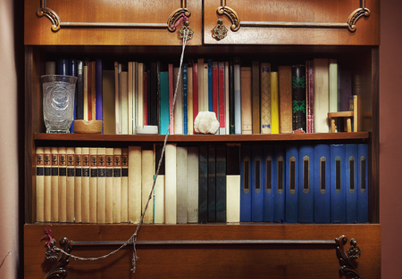 Closeup view of old closet full of old books.  Фото со стока