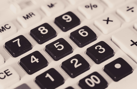 Closeup view of old and dusty calculator plastic buttons.  Фото со стока