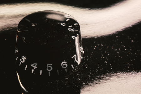 Details of an electric guitar volume knob, macro view.