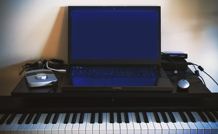 Equipment of a small home recording audio studio.