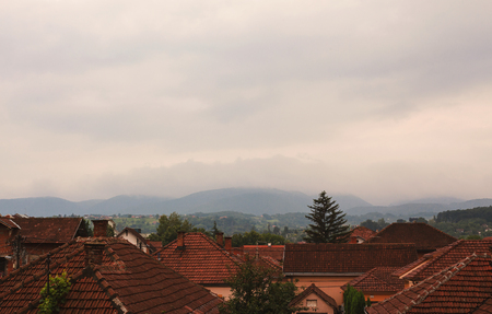 Rainy summer day over small Balkan town.