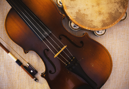 Details of an old and dusty violin from Czechoslovakia and tambourine.