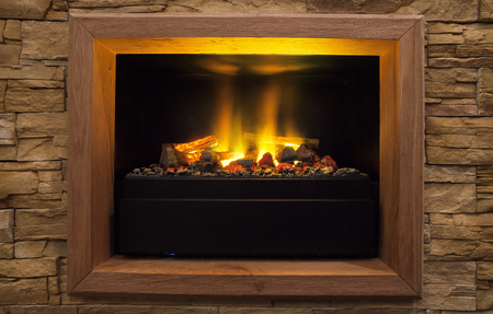Home interior decor, details of modern artificial fireplace.