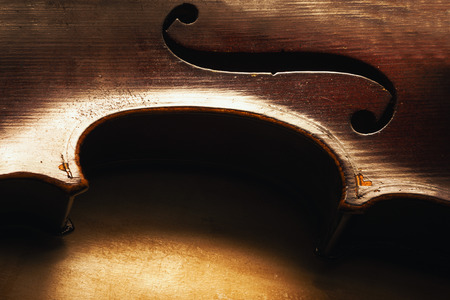 Closeup view on old dusty violin, details of wood and structure. Stock Photo