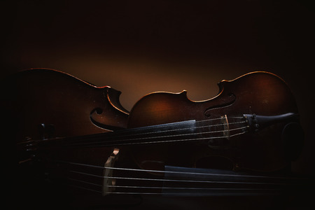 Details of old violin and cello, accentuated shapes and textures.