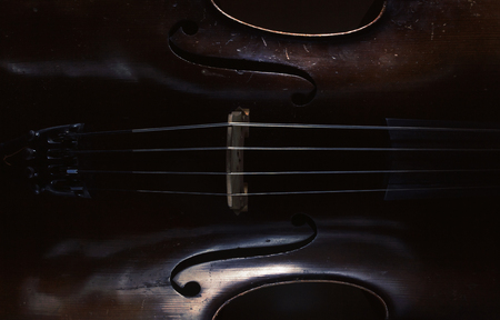 Abstract of an old cello, accentuated shapes and texture. 写真素材