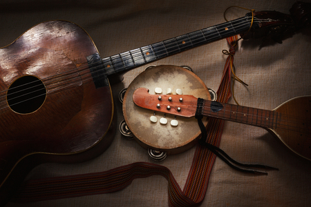 Original Balkan string and percussion instruments, part of Serbian, Croatian and Hungarian tradition and folklore. Stock Photo