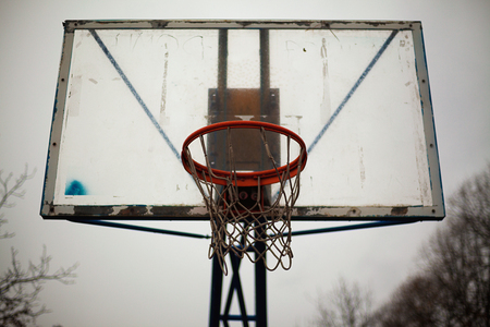 Under the old basketball hoop, bad weather during autumn.  Stock Photo