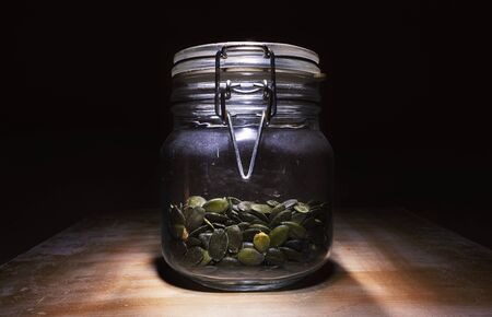 Dry sunflower seeds in a glass bottle.