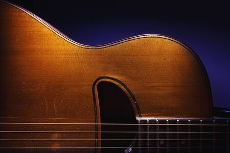 Details of an old and dusty gypsy jazz acoustic guitar, Django style. Banco de Imagens
