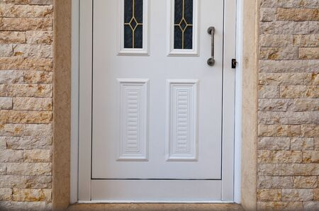 Abstract of white closed door, entrance of a house.