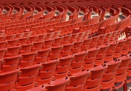 Red Stadium Seats in a Semicircle Pattern Reklamní fotografie