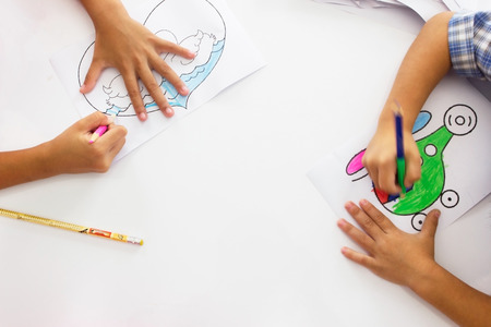 coloration: A child drawing coloration. Stock Photo