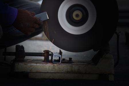 tool and die: Cutting metal with grinder,Sparks while grinding iron. Stock Photo
