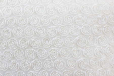 fondling: Fabric romantic rose blossom   texture and background. Stock Photo