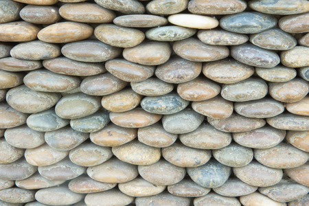 knobby: Modern wall decoration by arrangement pebble. Stock Photo