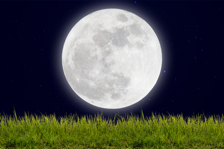 full moon romantic night: Full moon with stars and field of green hill on darkness sky. Stock Photo