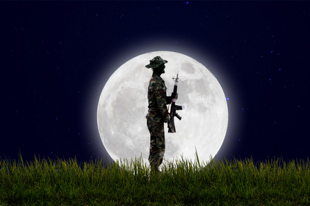 guerrilla warfare: Soldiers on the field in the fullmoon night. Stock Photo