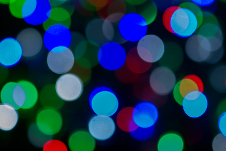 glister: Colorful circles of light abstract background.