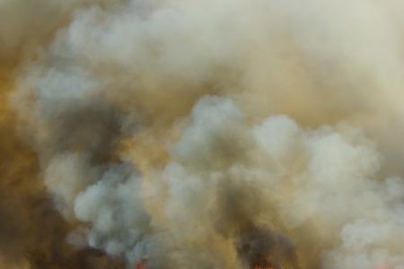 thick dark smoke in a fire Stock Photo