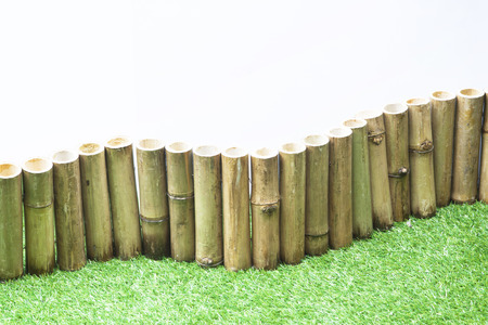 accommodation space: artificial green grass and bamboo for decorate in office.