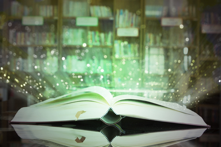 glister: Image of opened magic book with glister lights. Stock Photo