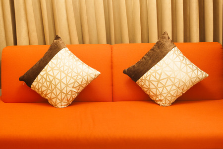 suede: Two pillows on the sofa. Stock Photo