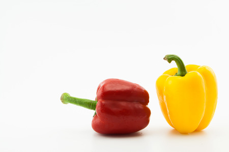 Yellow and red pepper on white background.Healthy concept.