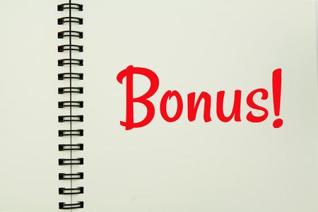 bonus key in open notebook. Stock Photo