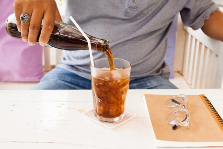 Fat man with soft drink . Stock Photo
