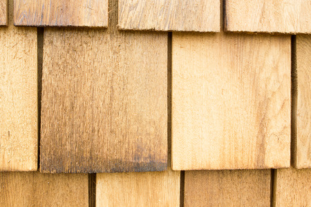 cedar shakes: Close up of brown wood roof shingles.Wood background.
