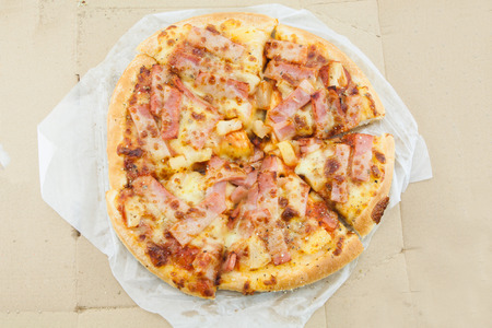 piece paper: Delicious pizza with cheese.
