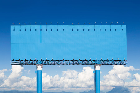 customizable: Blank billboard for advertisement with sky, business advertising concept. Stock Photo