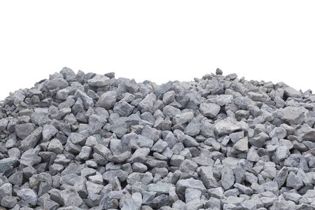 Piles of crushed stone isolate on white. Banco de Imagens