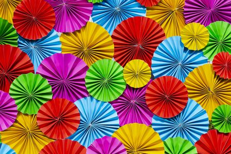 Colorful paper flowers texture or background.
