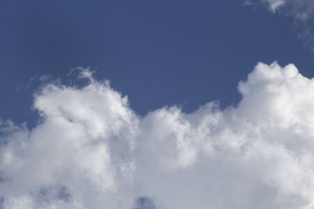 Clouds in the blue sky. White fluffy clouds in the blue sky.