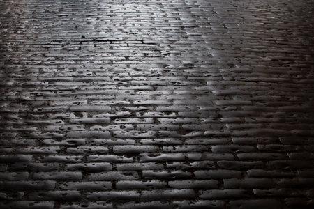 Old cobblestone pavement close up. Vintage concept. Фото со стока