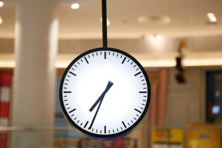 Clock with blurred background .