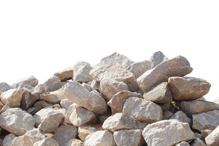Piles of crushed stone isolated on white background. Фото со стока