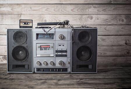 old tape recorder and cassette on wooden background Standard-Bild