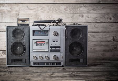 old tape recorder and cassette on wooden background Stock fotó