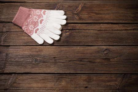 gloves on old wooden background