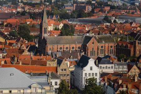europe vintage: Wide angle panoramic view from above the top of Belfry vantage point to roofs of ancient medieval Europe city Bruges