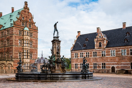 king neptune: Hillerod, Denmark - September, 24th, 2015. Frederiksborg castle square and Neptune fountain. Frederiksborg Slot is royal residence for King Christian IV in the past and a museum of national history nowadays.