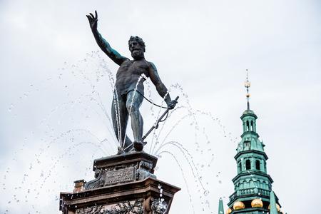 king neptune: Hillerod, Denmark - September, 24th, 2015. Neptune fountain and copper spiel at Frederiksborg palace near Copenhagen.